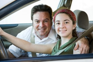 Teen girl in car with father