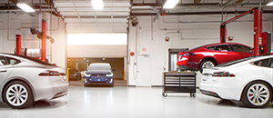 A Tesla service bay. Auto dealers say customer service could suffer if automakers are allowed to sell direct-to-consumers as opposed to selling through a dealer.