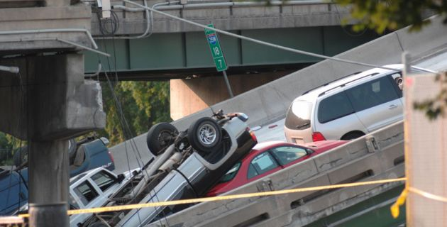 bridge collapse with cars on it.