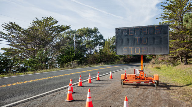 Roadway-sign header